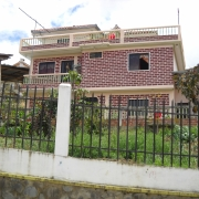 Authors' photo of home purchased with remittances in Ecuador